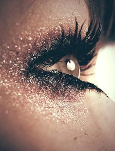glitter eye.  Ton of glitter= beautiful and mystical.[; adds wonder to the eyes you can almost say!
