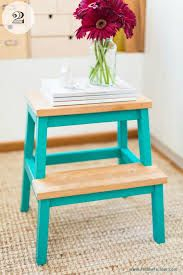 Like the idea of just painting the legs and staining the wood rather then painting the entire step. More