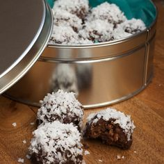 """COCONUT GANACHE  BOURBON BALLS -- from theKitchn. Mind you, these little """"shots"""" of heaven are not for the faint of heart -- they're called bourbon balls for a reason. I'd keep them away from the kids table if I were you."""