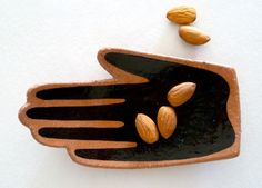 """Each 'Mano"""" dish is cut from rolled midfire clay using a template traced from my own hand. They are carefully shaped into a gentle curve then individually painted in black or white. 14cm L x 8cm W x 1.5cm HLeft and right is as your hand is out palm up."""