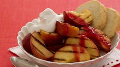 Brush grilled peaches with butter and brown sugar, grill, then top with a fresh raspberry purée. So easy. Get the recipe!