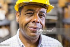 Stock Photo : Close up portrait of man in stockroom wearing hard hat