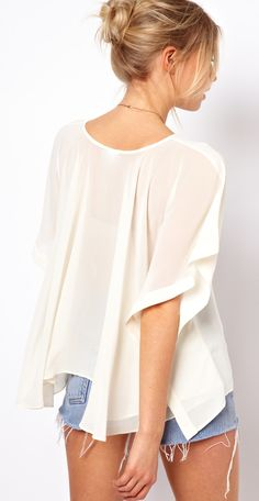 Love this flowy top - can be worn with jeans, trousers and even a pencil skirt.