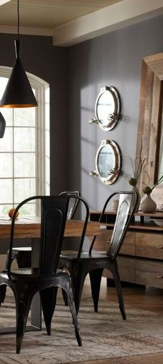 Charcoal walls, metal chairs, sunny colored wood...  Marco Polo Imports | Dining Room