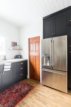 Black inset cabinetry completes a rustic modern kitchen.