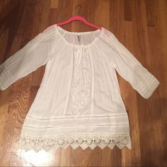 Peasant white tunic White peasant tunic top. Comfy and versatile with pretty embroidered detail. Size small. Can be worn as a dress or a cover up. Cute with leggings or jeans. Manarrero Tops Blouses