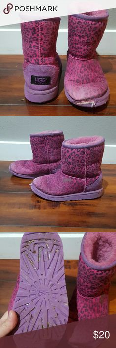 Girls UGG boots, size 1, pink and purple Girls pink and purple Leopard print UGG Boots, size 1.  The toes have been loved! There is also a stain on the left boot, please see pictures for condition. UGG Shoes Boots