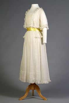 "White cotton dress with yellow polka dots, American, circa 1917, via KSUM.  This dress is currently on view in ""The Great War: Women and Fashion in a World at War, 1912-1922"" until July 5, 2015."