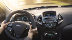 Ford KA+ interior with steering wheel and SYNC touchscreen