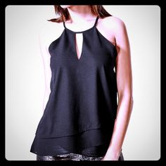 Guess Flora Layered Tank This everyday staple can be worn day or night. Sexy chiffon is finished off with a soft layered hem and keyhole at the neck. Guess Tops Tank Tops