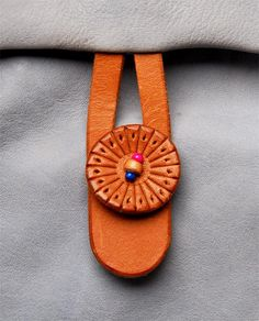 """leather tooled button closure..""""Spoony says"""": Another version of a closure latch."""
