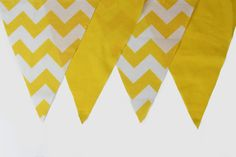 "Tree decor. 52"" long w/ 7 flags. $13.50. Yellow, pink, grey"