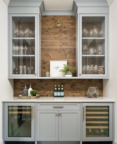 The blue-gray Butler pantry painted in Benjamin Moore Solitude … The blue-grey butler's pantry, painted in Benjamin Moore Solitude features beverage and wine refrigerators and beautiful glass front cabinetry. Wood shiplap backsplash is Knotty New Kitchen, Kitchen Dining, Kitchen Decor, Kitchen Pantry, Dining Room With Bar, Cabinets In Dining Room, Bar Cabinets For Home, Kitchen Wet Bar, Dining Room Storage
