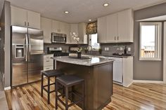 Traditional Kitchen with 33 in. W 22 cu. ft. Built-in Side by Side Refrigerator in Stainless Steel, Raised panel, L-shaped