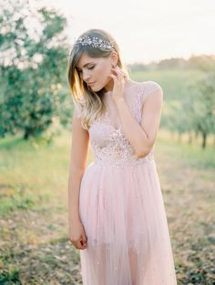 Best Wedding Details for a Valentine's Day Color Palette | This blush wedding dress makes for an unconventional look that doesn't stray too far from traditional. If you're going to get married on the most romantic day of the year, it's only fitting you look as swoon-worthy as this bride.