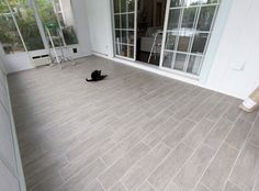 """wood"" tile flooring for sunroom Grey Wood Tile, Wood Tile Floors, Grey Tiles, Hardwood Tile, Porch Flooring, Kitchen Flooring, Grey Flooring, Kitchen Tile, Flooring Ideas"