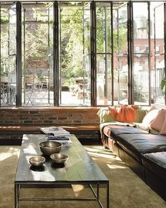 Windows, cushy couch, table.