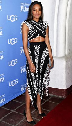 Naomie Harris in a black and white Proenza Schouler crop top and midi skirt