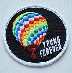 3 wide full color embroidered patch with iron-on backing, depicting the iconic hot air balloon from BTS album Young Forever day version. Can be ironed on to a jacket, beanie, or tote bag... a unique way to show the world youre an ARMY! Here is a handy guide to adhering your iron-on patch to fabric: http://www.wikihow.com/Iron-on-a-Patch *please note* because this patch has a lot of stitches packed in tightly together, there may be some slight variations in the stitching to ...