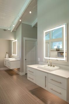 Dual Vanities in Master Bathroom with lighting underneath for night time. By Nest Design