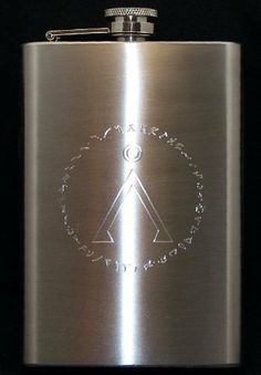 Earth Chevron Symbol Engraved Stainless Steel 8 oz. Flask - with Stargate Glyphs by Spiffy Custom Engraved Flasks. $14.50. Brushed Stainless Steel 8 oz. Flask features precision rotary engraved design. Handsome, Classic Style Flask is constructed on Quality Food Grade Stainless Steel. Captive Screw Down Cap is tight-fastening to prevent spillage of your favorite beverage. Swing Hinge anchors lid so it remains securely attached to flask -  No chance of misplacing the top du...