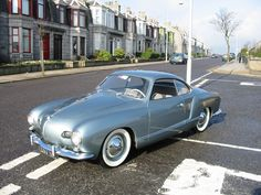 "Volkswagen Karman Ghia: This is an early ""Low Nose"" car, distinguished by lower headlamps, smaller ""nostril"" intakes, and smaller taillights."