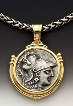 187. This stunning large pendant encircles a rare silver coin minted 250-300 BC of the Greek goddess of war and wisdom, Athena. This coin displays the profile of the famous helmeted goddess within a gold setting that includes wrapped details and a beautiful wide bail. The pendant is strung on a sturdy yet elegant woven sterling silver chain. Erez Epshtein & Hanan Engel. ownapieceofhistory@yahoo.com.