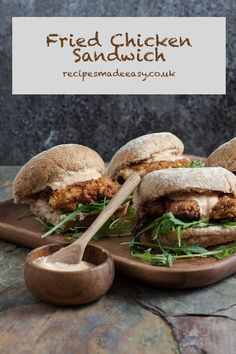 A Fried Chicken Sandwich made with tender chicken in a spicy coating can be Hard to resist. Freshly made at home this simple but tasty recipe is a joy to eat, served with a little spicy sauce in a soft bread roll. #friedchicken #friedchickenwithoutbuttermilk #easyrecipe #Comfortfood via @jacdotbee