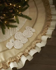 ivory velvet quilted fabric, taupe burlap, ruffle,white sateen ruffle  ( then make stockings to match and embelish with clear & faint blu rhinestones) (no round flowery things)