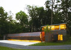 Gluck+'s Stunning Ultramodern Guesthouse Features Corrugated Copper Hangar Doors | 6sqft