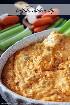 Delicious & Creamy Crockpot Buffalo Chicken Dip - This is my go-to buffalo chicken dip recipe for parties. Best when loaded with cream cheese & Frank's red hot sauce and served with celery or chips. An awesome yet simple party appetizer made in a slow cooker…if you keep it in the crock pot, it stays hot the whole time! mmmmmm my mouth is drooling just writing this!!
