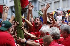TRADITIONAL PLANTING: Members of the Meyboom brotherhood planted the Meyboom tree in Brussels on Friday. The traditional event celebrates the 1213 victory of Brussels over the neighboring city of Leuven, Belgium. (Yves Herman/Reuters)