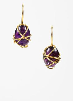 Highly collectible vintage earrings from Tina Chow, renowned jewelry designer, model, and fashion icon. This sculptural design embodies Chow's abstract aesthetic and trendsetting use of different sett