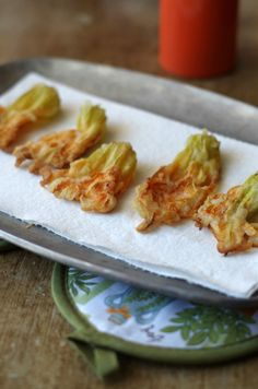 Italian recipe for fried zucchini blossoms passed down from my Nonna. Made just a little healthier. Only 4 ingredients! One bite and you will be in heaven! www.tasteofdivine.com