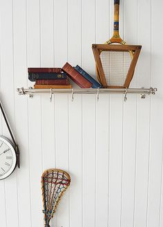 Vintage style chrome luggage shelf for hallway furniture. An elegant coat rack with a shelf
