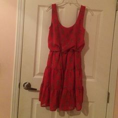 Red Summer Dress Beautiful red dress to wear in the summer. Has a design on it. Worn once. In great condition. No visible flaws. Has little loops on each side to hold a belt in place if you choose to wear one as shown in last picture. Was purchased without a belt. City Triangles Dresses Mini