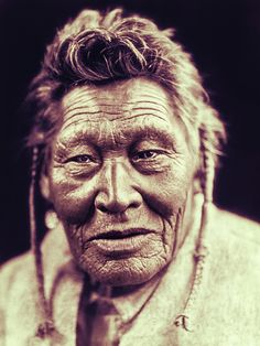 Restored vintage portrait of Tsaassi-Mis-salla, a Sarsi Indian. Original photograph from 1910 by Edward S. Curtis.