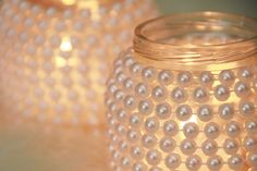 DIY candle holder jar. I like this idea... maybe try it with fewer pearls, just at the bottom and top or try using mardi gras beads :-)