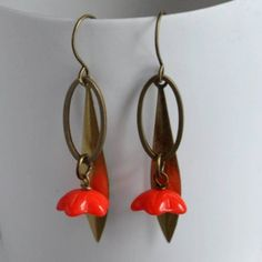 Coral Longleaf Bell Flower Earrings from ArtySmartyShop.com  Gorgeous antiqued brass and Czech glass dangly bell flower bead earrings on an elegant hook.These dainty hanging leaf earrings made from antiqued brass and a pretty coral bell flower Czech glass bead, are inspired by the Irish countryside and turned into a contemporary piece to wear into our Dublin studio where we handcraft each of our beautiful pieces.  #artysmarty #jewelry #fashion #handmadejewelry #styleinspiration Leaf Earrings, Flower Earrings, Earrings Handmade, Handmade Jewelry, Coral Bells, Czech Glass Beads, Beaded Flowers, Dublin, Countryside
