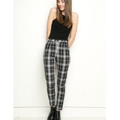 Brandy Melville Plaid Taylor Leggings Slim fit high-waisted leggings in window-plane plaid print with a side zipper opening and elasticized waist, fits a size 00-2. Brandy Melville Pants
