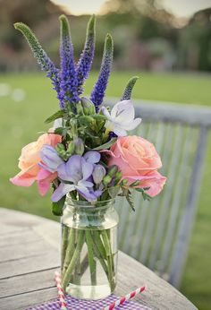 pale pink, purple and peach flower arrangement | Photo by Marianne Taylor