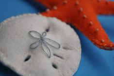 ADORABLE sand dollar and star fish out of felt.