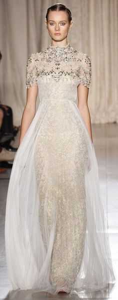 This Marchesa gown that really amps up the glam.  Beading, shimmer, and sleeves make this perfect for an evening affair.