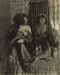 Pola Negri in the mirror.  This may be from the lost version of The Cheat, 1923.