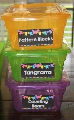 I love the look of black labels on colorful tubs! The tubs came from The Dollar Tree!!! Cute supply labels!! LOVE brights on black classroom decor!!