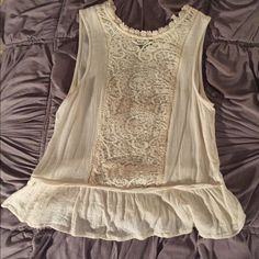 Forever 21 peplum crochet tank top Cute crochet Lacey front cream top. Semi cropped fit. Peplum flounce hem. Button at top of back. Really cute details. Sz xs. No trades Forever 21 Tops Tank Tops