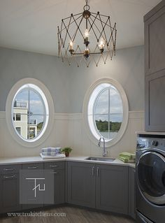 ... In The Laundry Room Through The Layout And Color Choices In This  Stunning Remodel. Arenu0027t The Gray Shaker Cabinets From Grabill Cabinetry  Beautiful?