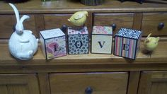 Blocks I made.  4x4 wood, spray paint, scrapbook paper, modge podge and letters