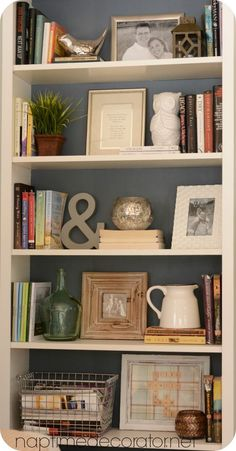 While these items aren't necessarily what would go with your decor, they show how to use a nice variety of items to style a bookcase. Your eye wants to bounce around and see everything!: