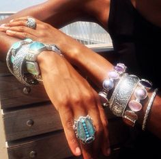 Stephen Dweck arm stack and statement ring.